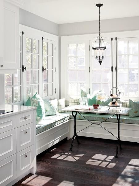 The soft green and dark floor look amazing with the white woodwork — or is it t
