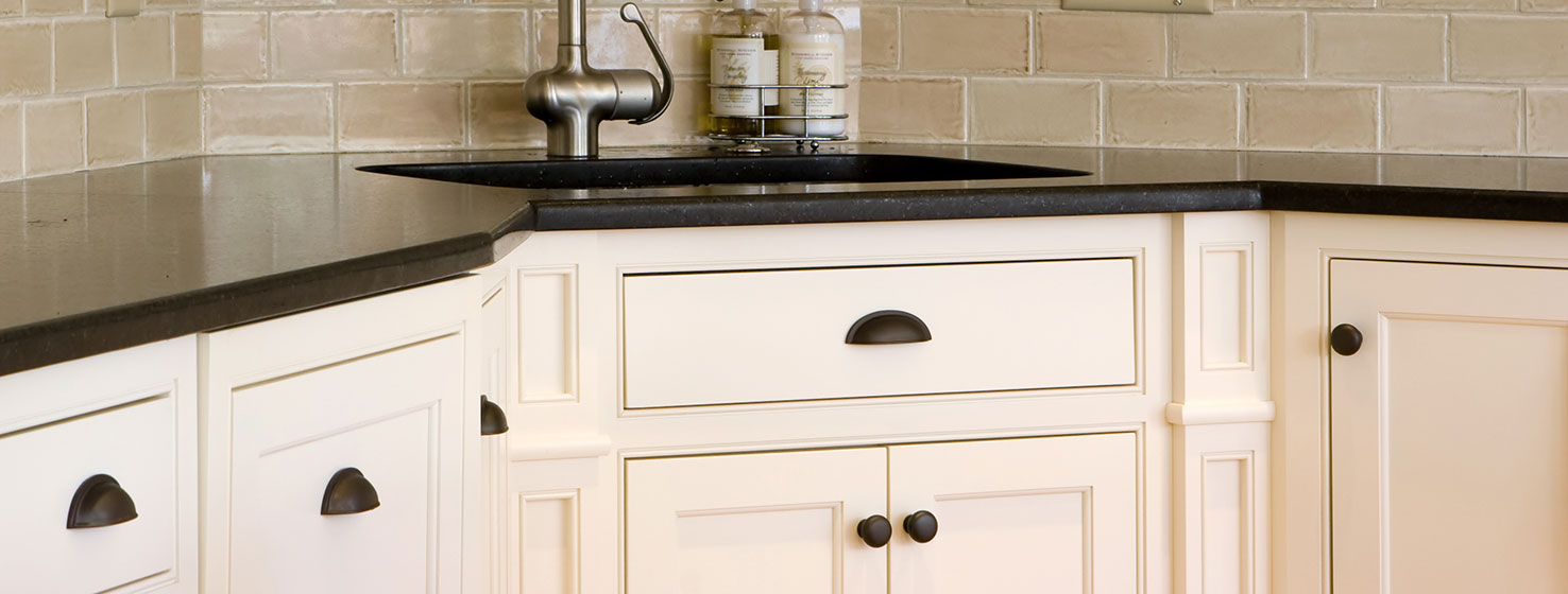 Kitchen Cabinets Painted White Under A Black Countertop