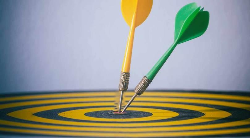 photo of darts in a bullseye