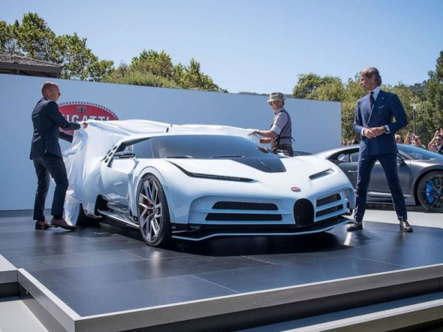 PHOTO: Stephan Winkelmann, president of Bugatti Automobiles SAS, right, watches the unveiling of the companys limited-edition Centodieci supercar in Carmel, Calif., Aug. 16, 2019.
