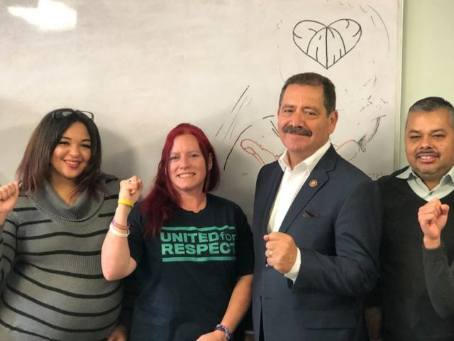 PHOTO: Congressman Jesus Garcia poses for a picture with United for Respect members, November 2019.