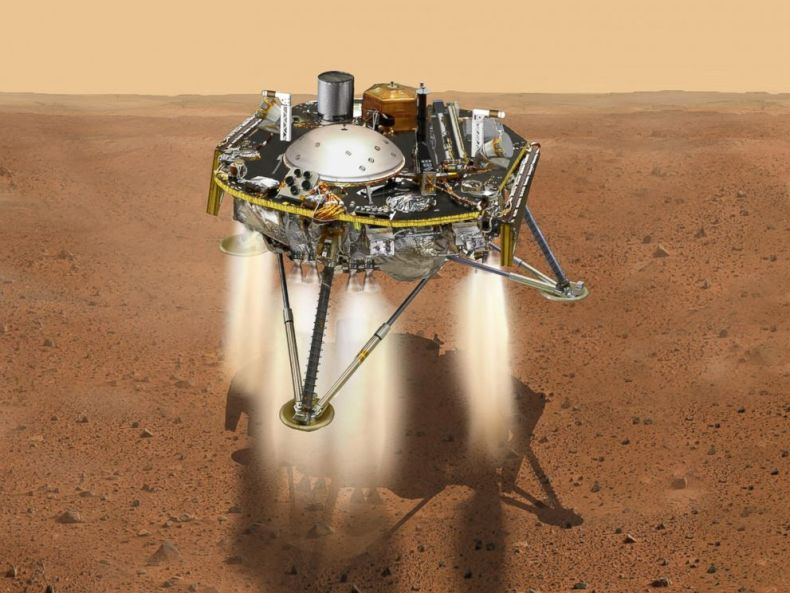 PHOTO: This NASA illustration shows a simulated view of NASAs InSight lander firing retrorockets to slow down as it descends toward the surface of Mars.