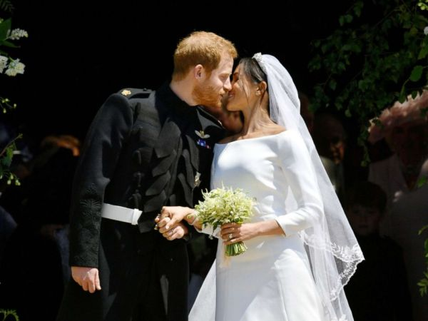Prince Harry, Meghan Markle seal their wedding with a kiss ...