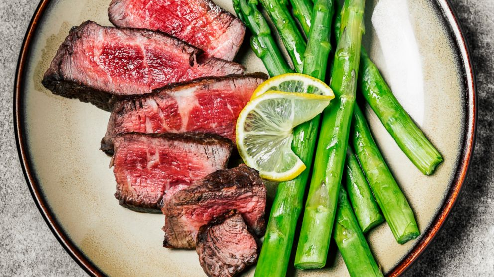 Sliced steak with asparagus is pictured in this undated stock photo.
