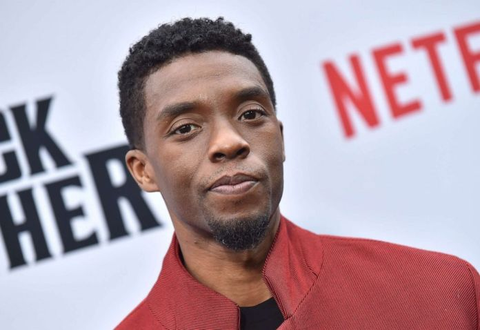 """PHOTO: In this file photo taken on June 3, 2019, actor Chadwick Boseman attends Netflix's """"The Black Godfather"""" premiere at Paramount Studios Theatre in Los Angeles."""