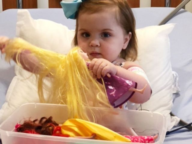 PHOTO: Lilah Joiner plays with a doll while in dialysis.