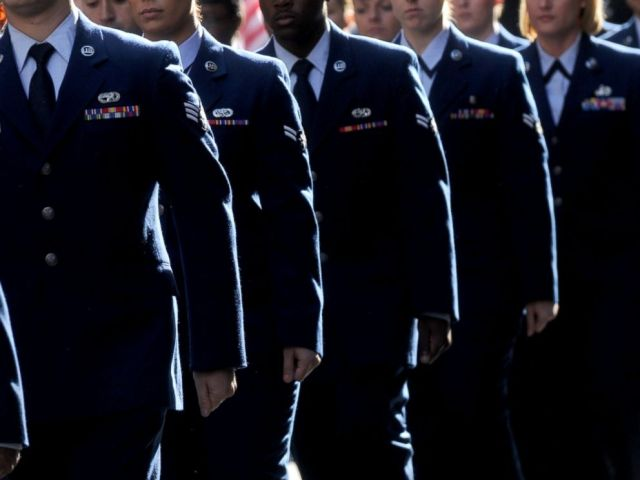 PHOTO: Members of the military march in a Veterans Day Parade in New York, Nov. 11, 2015.