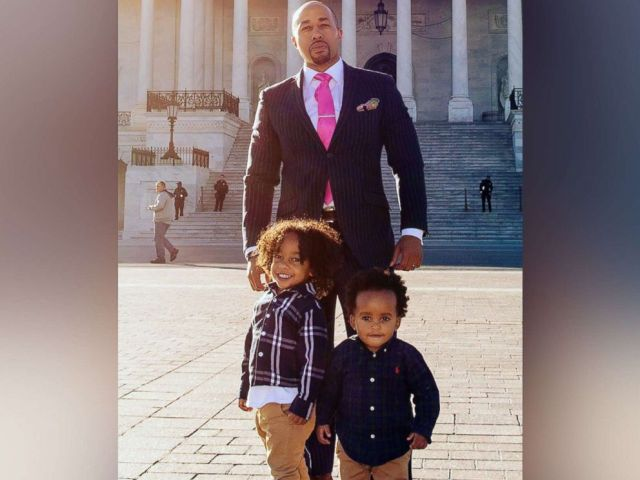 PHOTO: Charles Johnson poses for a photo with his sons Charles V and Langston Johnson in Washington, D.C. on Sept. 11, 2018, after the death of his wife Kira.