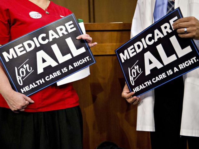 PHOTO: Attendees hold signs while waiting for a health care bill news conference to begin on Capitol Hill in Washington, Sept. 13, 2017.