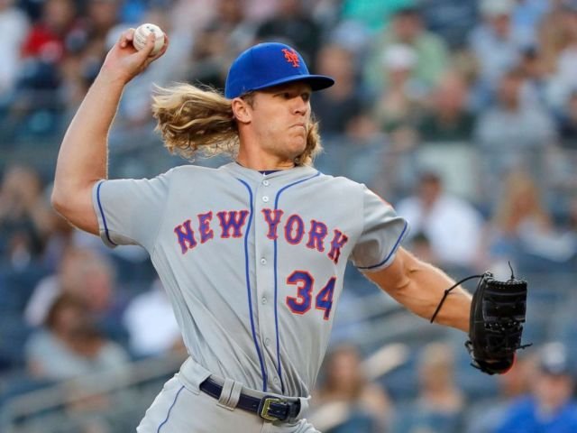 PHOTO: New York Mets starting pitcher Noah Syndergaard delivers against the New York Yankees during the first inning of a baseball game, July 20, 2018, in New York.