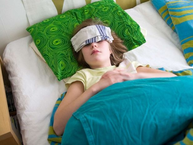 PHOTO: A sick girl lies in bed in this undated stock photo.