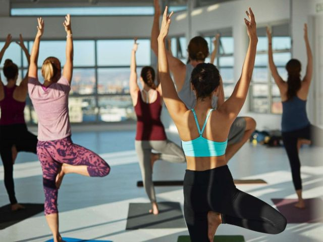 PHOTO: Women in a yoga class practicing in a huge rooftop studio in this undated stock photo.