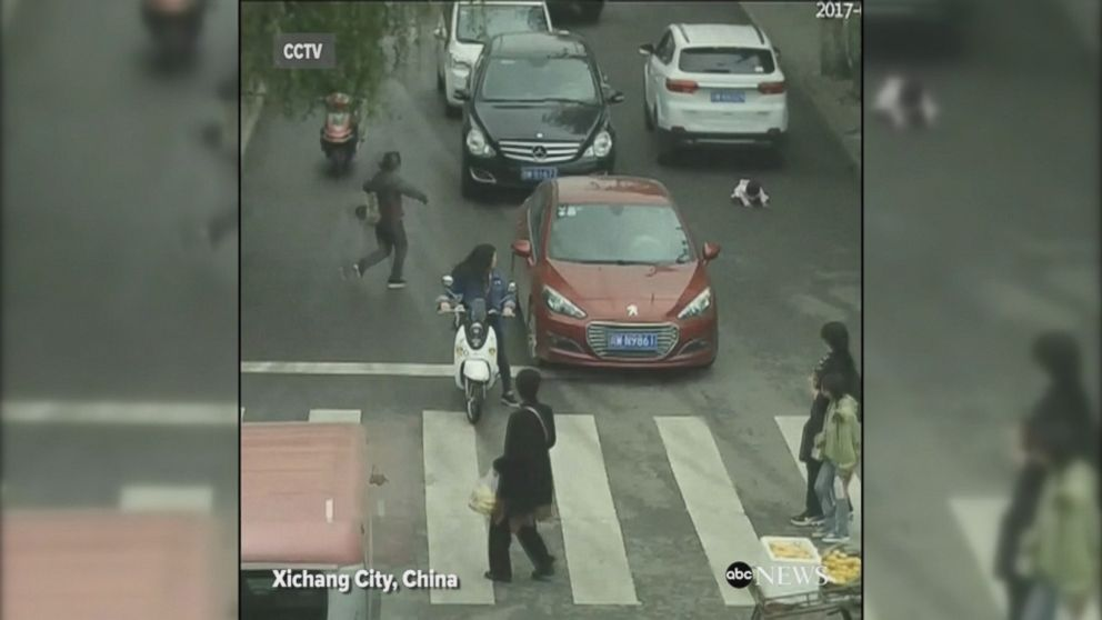 2 Year Old Survives Being Run Over By 2 Cars In China