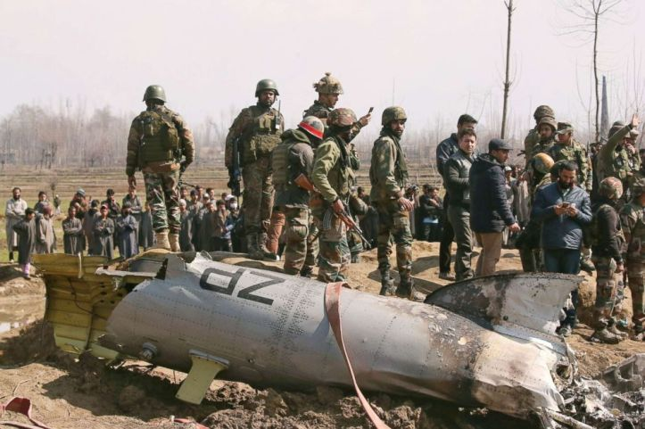 Indian soldiers stand next to the wreckage of an Indian Air Force helicopter after it crashed in Budgam district in Kashmir Feb. 27, 2019.
