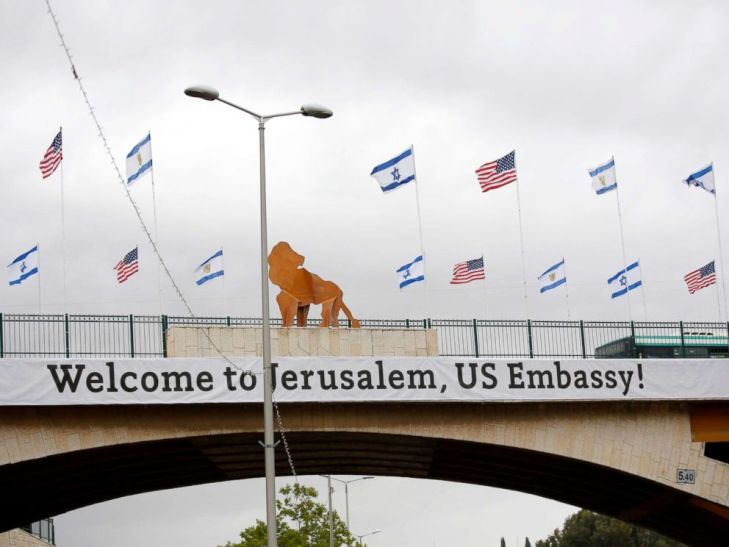 PHOTO: A sign and flags appear on a bridge nearby the US consulate that will act as the new US embassy in the Jewish neighborhood of Arnona, May 13, 2018.