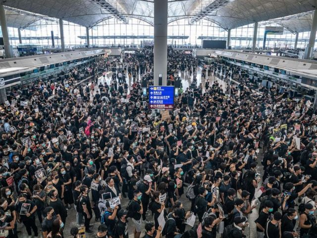 PHOTO: Protesters occupy the departure hall of the Hong Kong International Airport during a demonstration on Aug. 12, 2019.