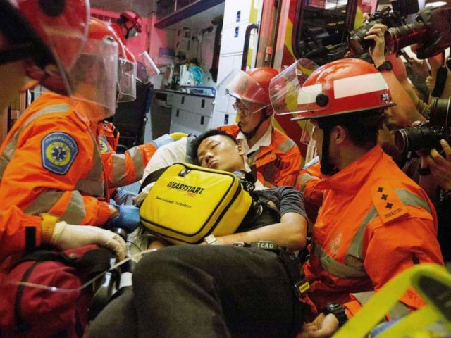 PHOTO: A man who protesters reportedly suspected of being an undercover Chinese policeman is taken away by medics at Hong Kong International Airport, Aug. 13, 2019.
