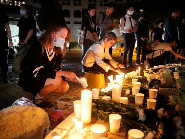 PHOTO: Protesters light candles to pay tribute to Chow Tsz-Lok in Hong Kong, Nov. 8, 2019.