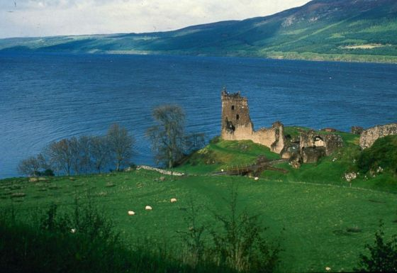 PHOTO: Scotlands 23-mile long Loch Ness, where some believe the elusive monster Nessie lives. Urquhart Castle looks out over the water.