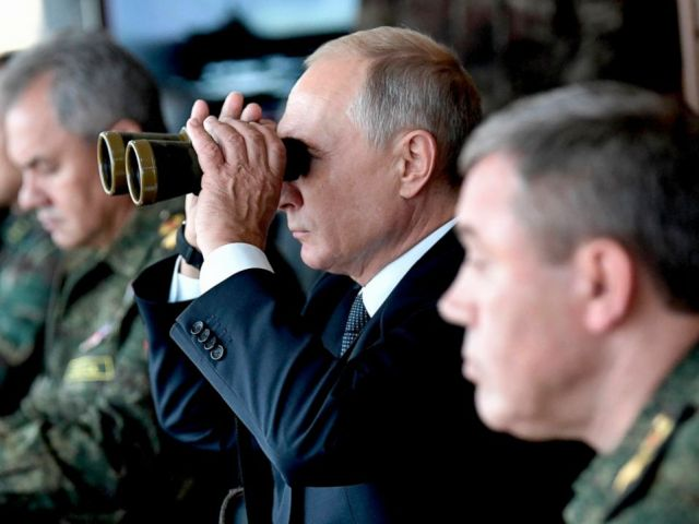PHOTO: Russian President Vladimir Putin looks through a binocular as he visits the training ground Telemba, during the military exercises Vostok 2018 in Eastern Siberia, Russia, Sept. 13, 2018.