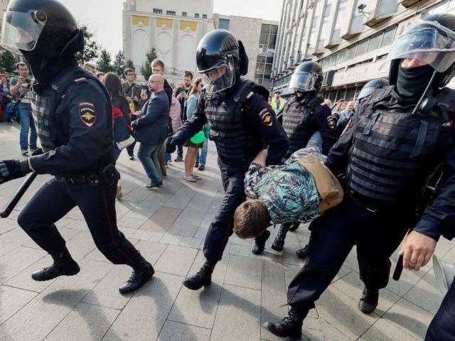 PHOTO: Law enforcement officers detain a participant in a rally calling for opposition candidates to be registered for elections to Moscow City Duma, the capitals regional parliament, in Moscow, Aug. 3, 2019.