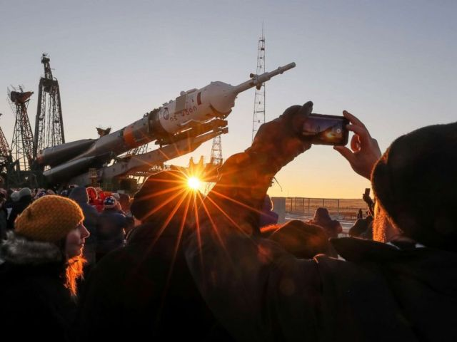 PHOTO: Spectators watch the Soyuz MS-11 spacecraft for the next International Space Station (ISS) crew, c is ready to be set on the launchpad ahead of its upcoming launch, at the Baikonur Cosmodrome, Kazakhstan Dec. 1, 2018.