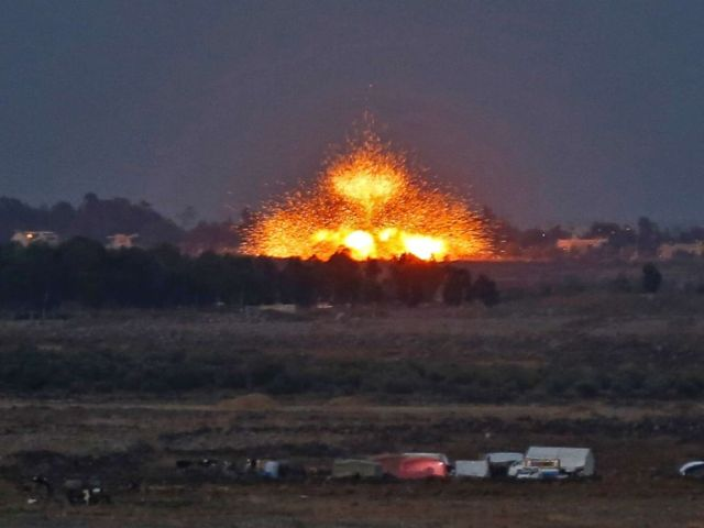PHOTO: An explosion caused by aerial bombardment across the border in Syria, during air strikes backing a Syrian-government-led offensive in the southwestern province of Daraa, July 23, 2018.