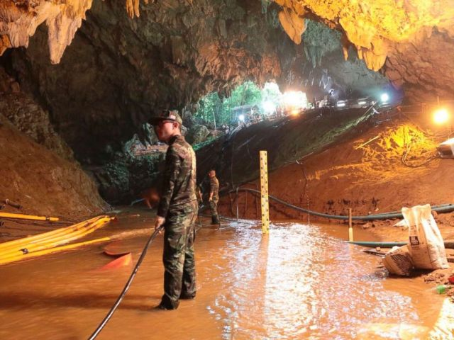 PHOTO: Thai rescue teams arrange a water pumping system at the entrance to a flooded cave complex where 12 boys and their soccer coach have been trapped since June 23, in Mae Sai, Chiang Rai province, northern Thailand in this undated photo.
