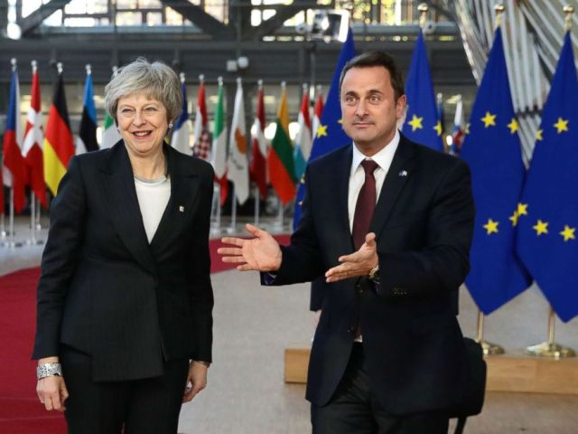 PHOTO: Britains Prime Minister Theresa May is welcomed by Xavier Bettel, Luxembourgs Prime Minister, at the European Council for the start of the two day EU summit on Dec. 13, 2018 in Brussels.
