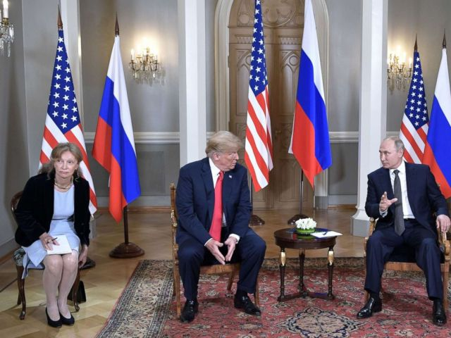 PHOTO: President Donald Trump meets with Russian President Vladimir Putin at the Presidential Palace in Helsinki, Finland, July 16, 2018. In picture at left is seen US interpreter Marina Gross.