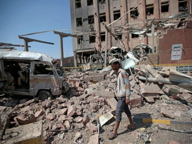 PHOTO: In this file photo of February 4, 2018, a man inspects debris after an air raid on Saudi Arabia in Sana'a in Yemen.