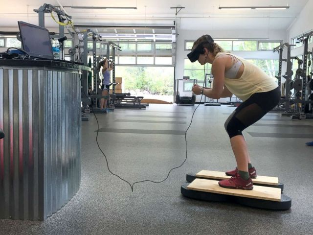 PHOTO: U.S. Olympic Alpine ski racer Laurenne Ross stands on a ski simulator while using virtual reality technology during a training session.