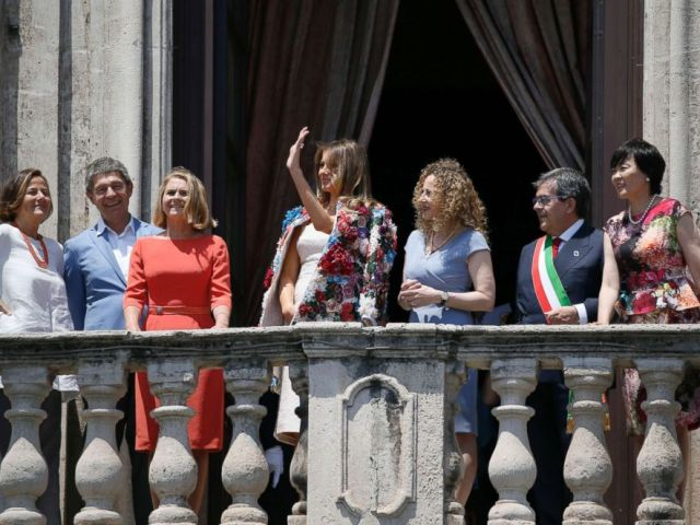 PHOTO: First lady Melania Trump, center, waves on the balcony of Chierici Palace, part of a visit of the G7 first ladies in Catania, Italy, May 26, 2017.