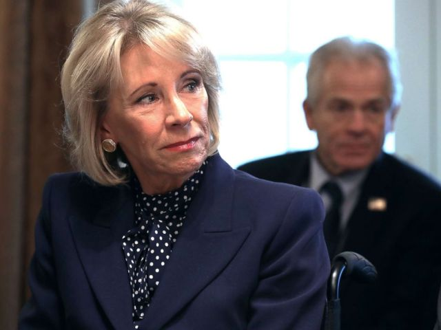 PHOTO: Education Secretary Betsy DeVos listens to U.S. President Donald Trump talk to reporters during a cabinet meeting at the White House in Washington, D.C., Feb. 12, 2019.