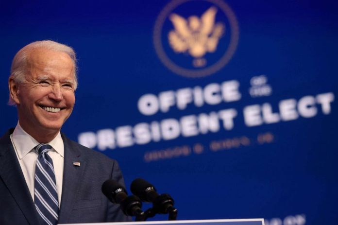 PHOTO: President-elect Joe Biden smiles as he speaks about health care and the Affordable Care Act at the theater serving as his transition headquarters in Wilmington, Del., Nov. 10, 2020.