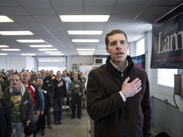 PHOTO: Conor Lamb, Democratic Congressional candidate for Pennsylvanias 18th district, and the audience recite the Pledge of Allegiance during a campaign rally with United Mine Workers of America (UMWA), March 11, 2018, in Waynesburg, Penn.
