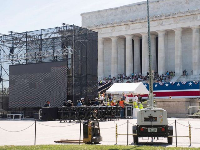 PHOTO: Workers build a stage and bleachers for the Salute to America Fourth of July event at the Lincoln Memorial on the National Mall in Washington, DC, July 1, 2019.