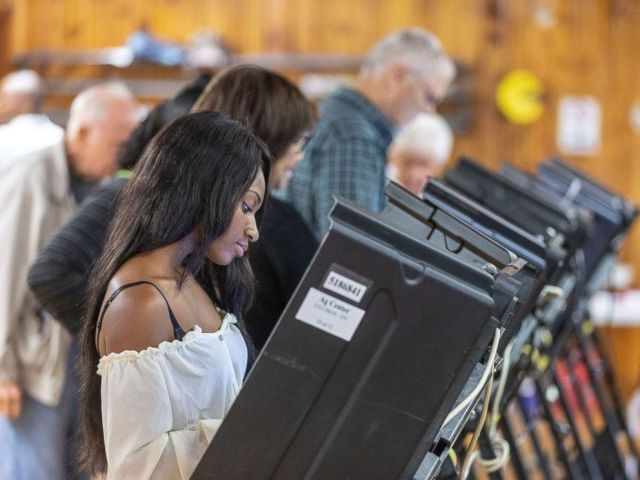 PHOTO: Alanna Jarvis votes on the first day of early voting in North Carolina, Oct. 17, 2018 in Greensboro.