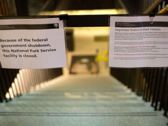 PHOTO: A sign announces the closure of the U.S. Parks Department Information Booth and Visitor Center because of the federal government shutdown, at Faneuil Hall in Boston, Dec. 24, 2018.