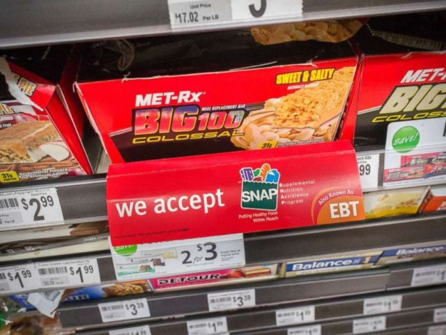 PHOTO: A sign on a sales rack of an energy bar in a 7-Eleven in New York on July 27, 2014 promotes the convenience stores acceptance of the SNAP (Supplemental Nutrition Assistance Program) formerly known as EBT.