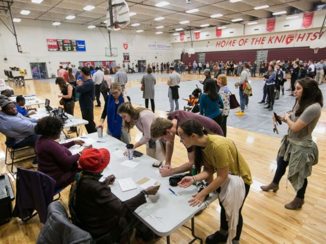 PHOTO: Voters line up to cast their ballots at a polling station set up at Grady High School for the mid-term elections, Nov. 6, 2018 in Atlanta.