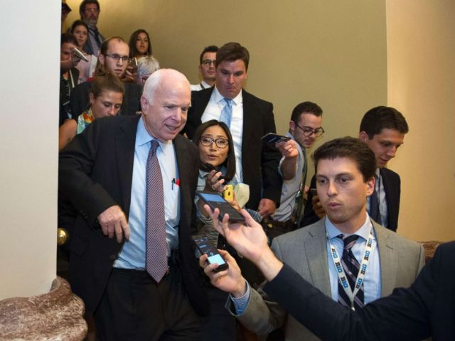 PHOTO: Sen. John McCain, front left, is pursued by reporters after casting a no vote on a measure to repeal parts of former President Barack Obamas health care law, on Capitol Hill in Washington, July 28, 2017.