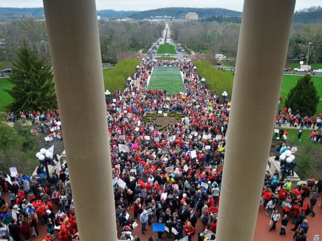 PHOTO: Teachers from across Kentucky gather outside the state Capitol to rally for increased funding and to protest changes to their state funded pension system, April 2, 2018, in Frankfort, Ky.