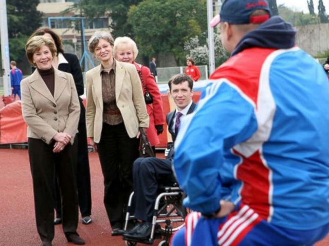 PHOTO: Mrs. Laura Bush visits with members of the Russian Paralympic Team Sunday, April 6, 2008, during a visit to Central Sochi Stadium in Sochi, Russia. Standing with her is her interpreter, Marina Gross.
