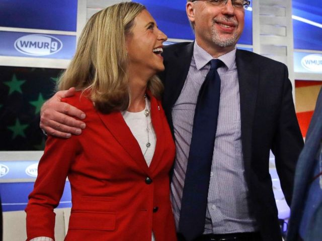 PHOTO: Levi Sanders, right, shares a laugh with Maura Sullivan following a debate for Democratic hopefuls in New Hampshires 1st Congressional District at the Institute of Politics at St. Anselm College in Manchester, N.H., Sept. 5, 2018.