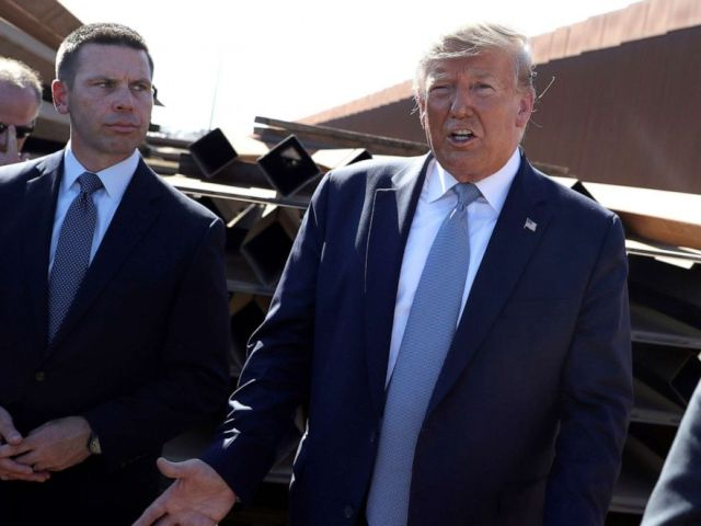 PHOTO: President Donald Trump talks with reporters as he tours a section of the southern border wall, in Otay Mesa, Calif., as acting Homeland Secretary Kevin McAleenan listens, Sept. 18, 2019.