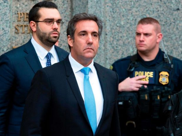 PHOTO: Michael Cohen, President Donald Trumps personal attorney, center, leaves federal court, in New York, April 16, 2018.