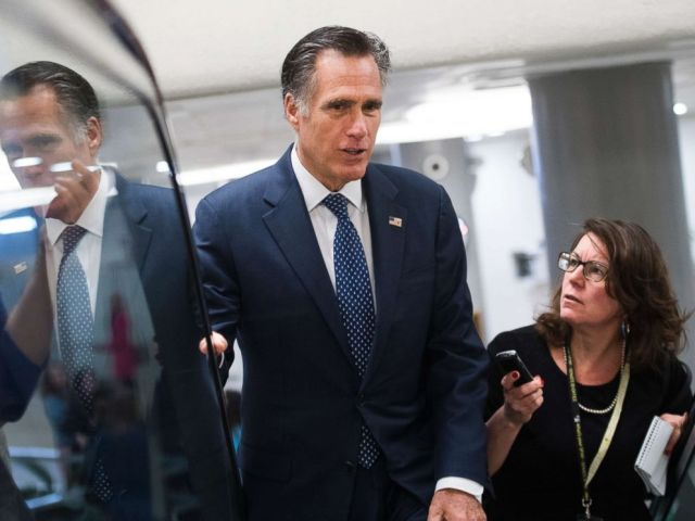 PHOTO: Sen. Mitt Romney talks with reporters before the Senate Policy luncheons in the Capitol, March 5, 2019.