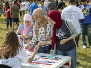 PHOTO: Women pick up literature at a My Muslim Vote rally in Dearborn, Mich., July 29, 2018.