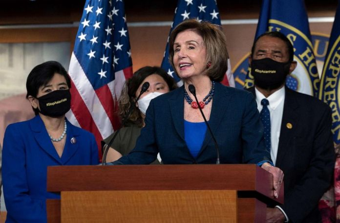 """PHOTO: Speaker of the House Nancy Pelosi speaks during a new conference with House Democrats and the Congressional Asian Pacific American Caucus on the """"Covid-19 Hate Crimes Act"""" on Capitol Hill in Washington, DC, May 18, 2021."""